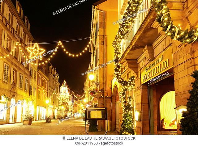 """""""""""""""""""""""Bartholdi"""""""" restaurant witn Christmas lights at the city center by night. Colmar. Wine route. Haut-Rhin. Alsace. France"""