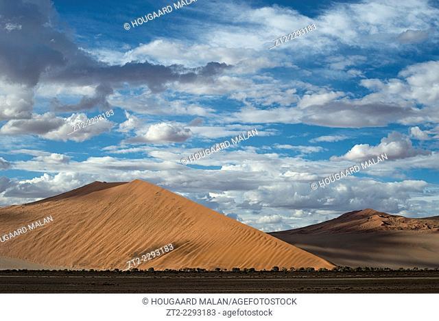 Landscape photo of soft light below a cloudy summer sky. Sossusvlei, Namib Naukluft National Park, Namibia