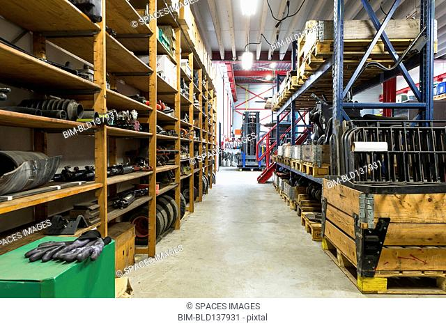 Shelves, tools and aisles in warehouse