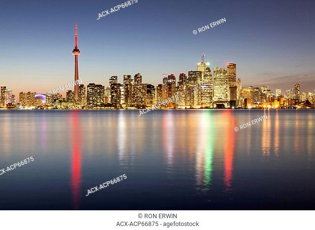 Evening lights on the City of Toronto Ontario Canada as seen from Algonquin Island - one of the Toronto Islands