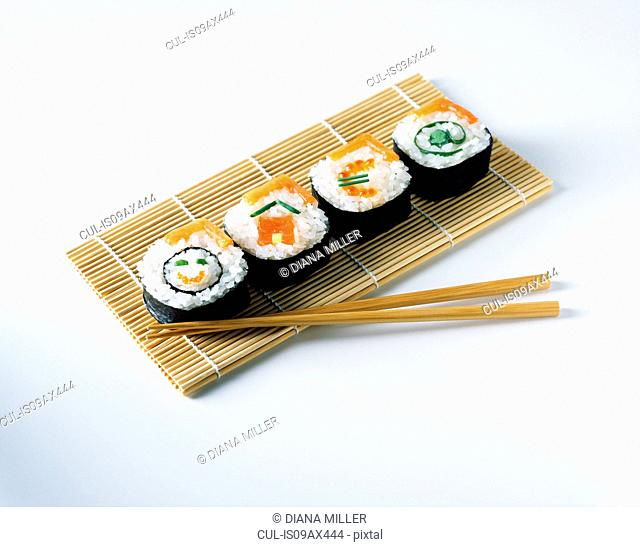 Salmon sushi on placemats with wooden chopsticks