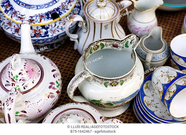 tea pot, jug, tea cup, porcelain saucers of English in a flea Market