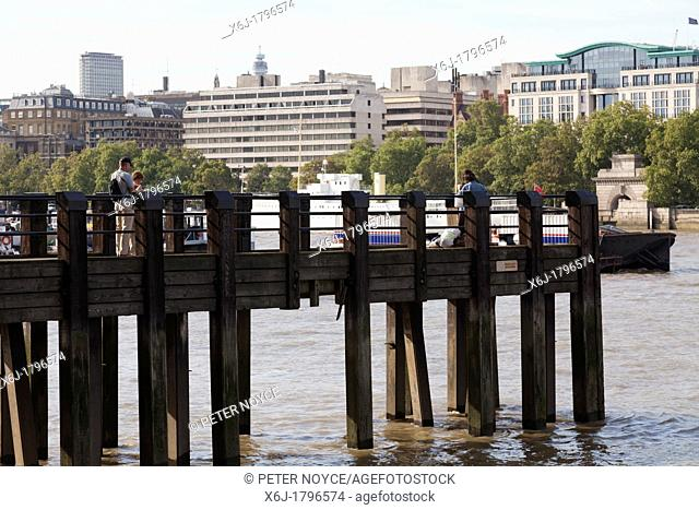 wooden pier over tyhe thames in London
