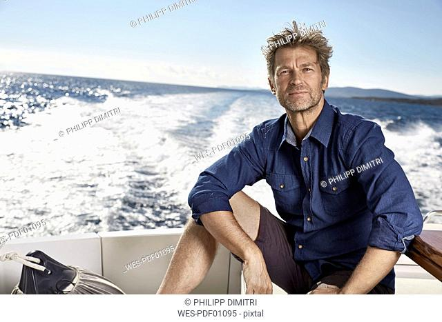Portrait of mature man on his motor yacht