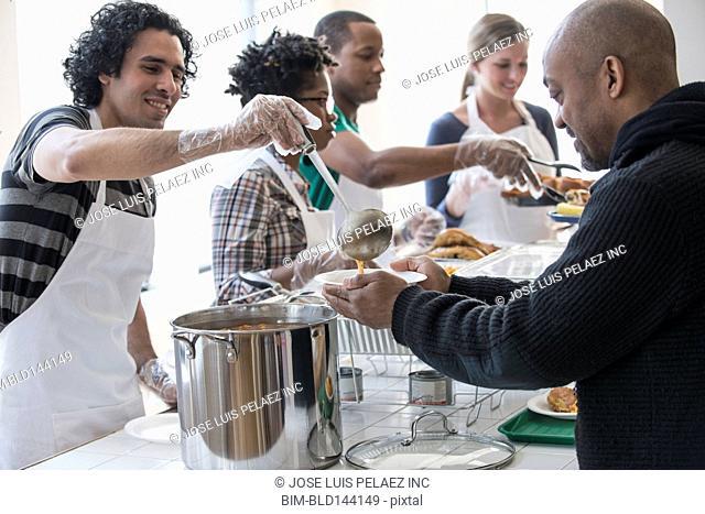 Volunteers serving food in cafeteria