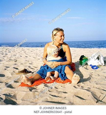 Mother and child on a beach, Skane, Sweden