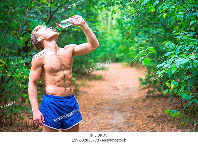Man drinking water after running banks
