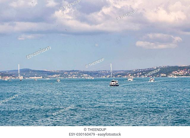 View of Bosphorus bridge and boats in Istanbul