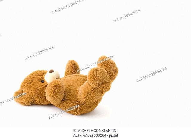 Teddy bear lying on back