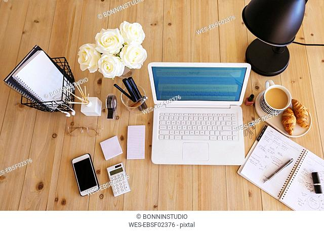 Laptop on desk in a bright and friendly office