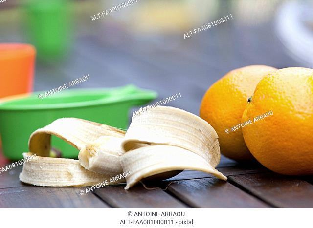 Oranges and half eaten banana