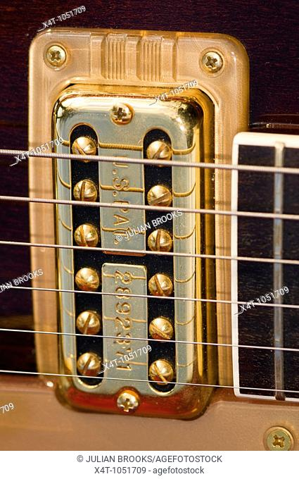 The strings and pickups of a Gretsch guitar, detail