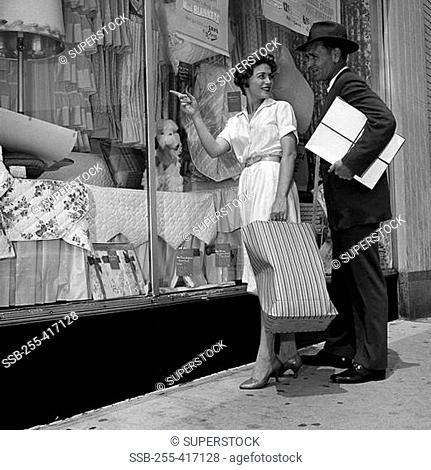 Mid adult couple window shopping