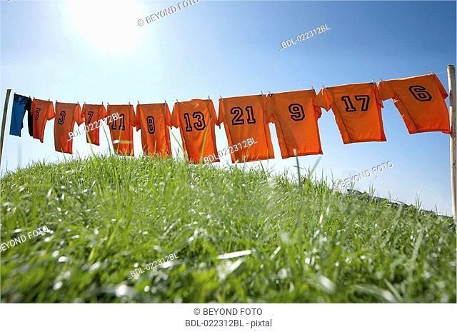 football dresses hanging on clothesline