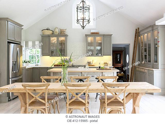 Wooden dining table in luxury kitchen