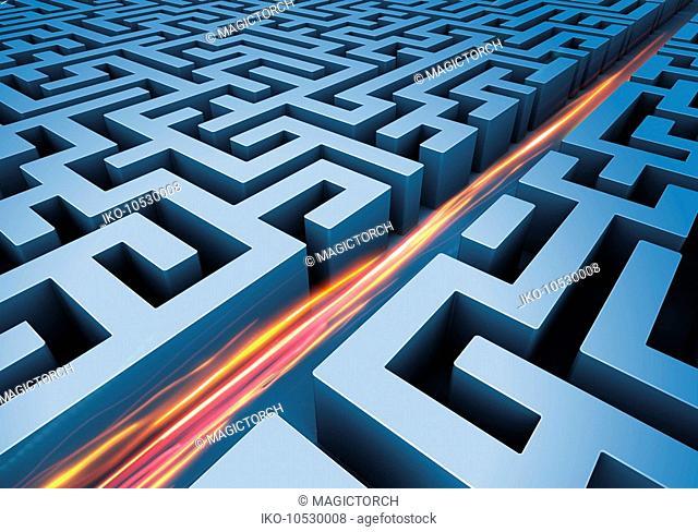 Light trails cutting path through maze