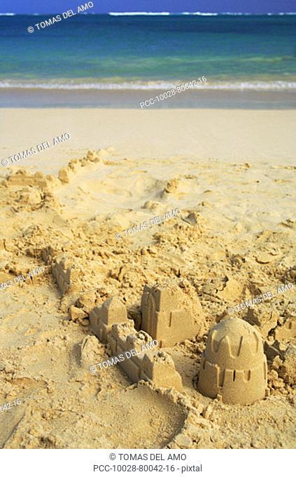 Partially built sandcastle on a tropical beach