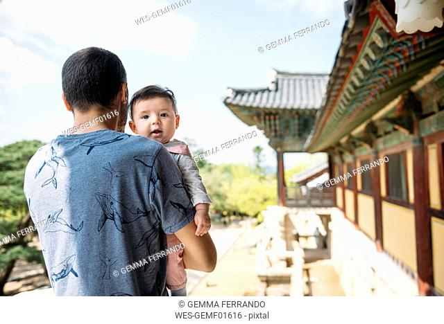 South Korea, Gyeongju, man traveling with a baby girl in Bulguksa Temple