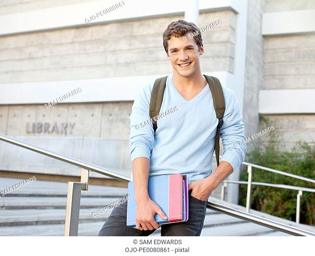 Student standing on steps outdoors