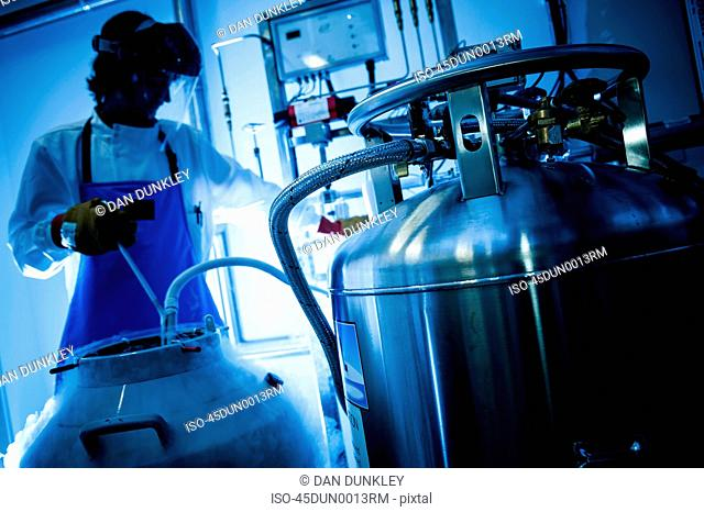 Scientist using gas tanks in lab