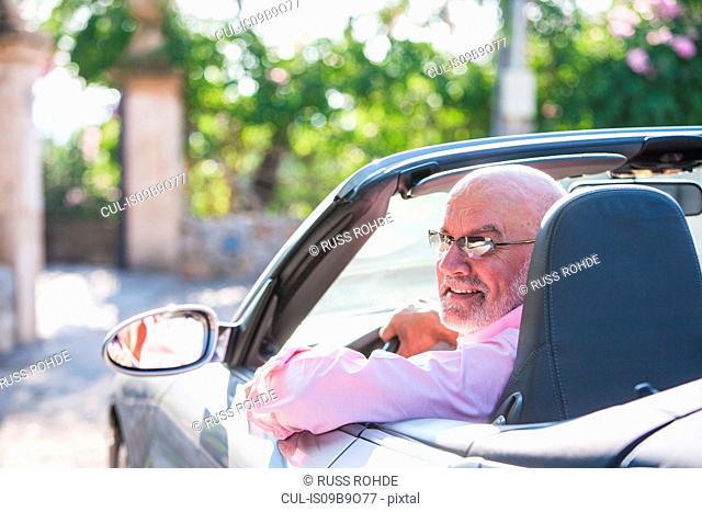 Portrait of senior man in convertible car