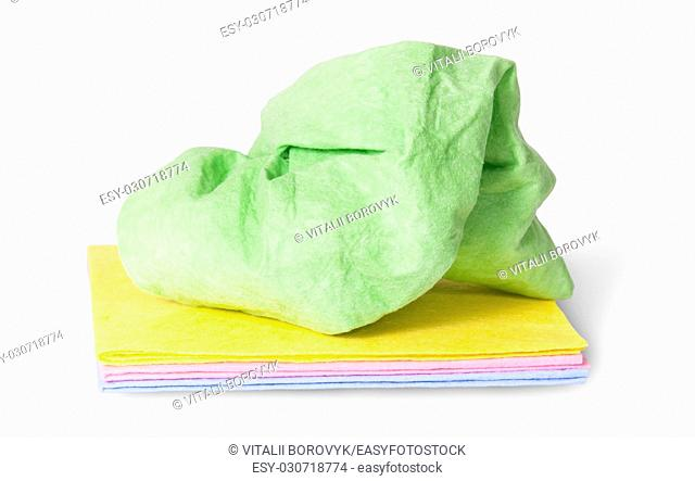 Multicolored stack cleaning cloths crumpled on top isolated on white background