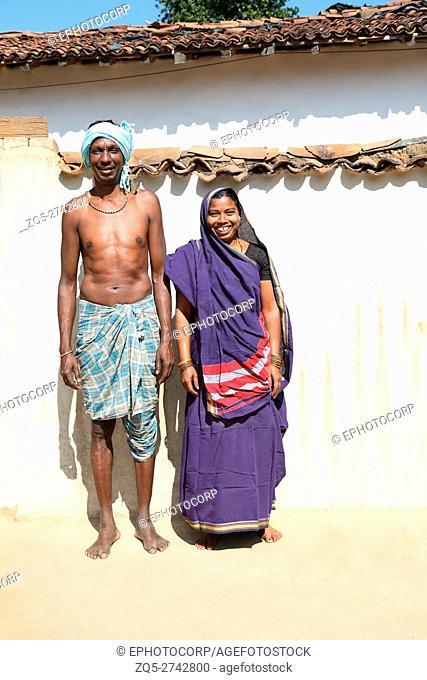 Couple standing outside home, BHARIA TRIBE, Kendaikhar village, Korba dist, Tahsil kathgora, Chattisgarh, India