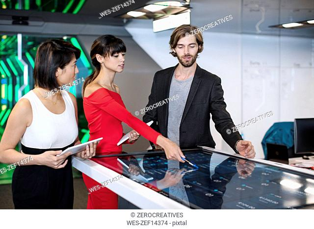 Business people discussing in futuristic office