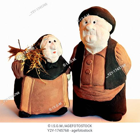 Couple of old europeans farmers made of clay