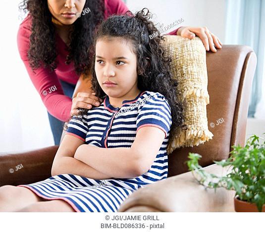 Mother comforting stubborn daughter
