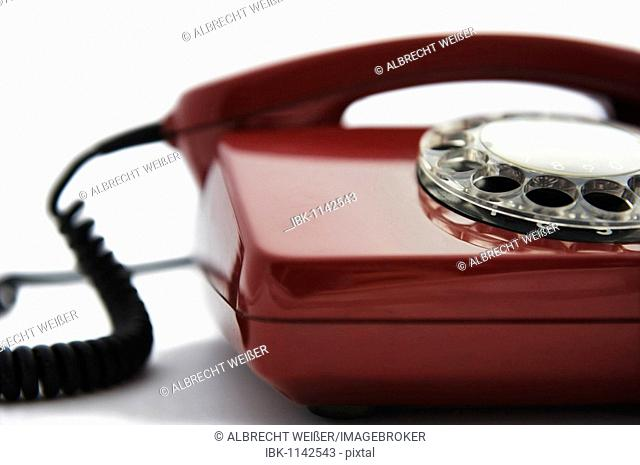 Detail of a red rotary telephone