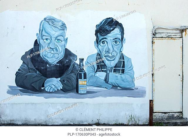 Mural showing the actors Jean Gabin and Jean-Paul Belmondo from the 1962 French film Un singe en hiver at Villerville, Calvados, Normandy, France