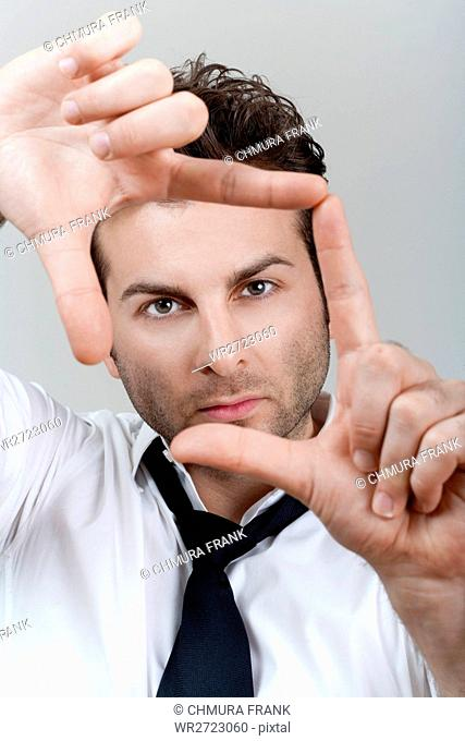 adult, background, business, businessman, Caucasian, composition, concept, creative, creativity, director, executive, expression, eyes, face, finger, fingers