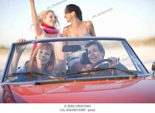 Girls with shades riding their cabriolet