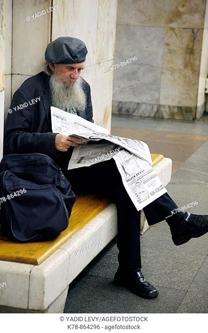 Sep 2008 - Man reading newspaper at the Metro station, Moscow, Russia