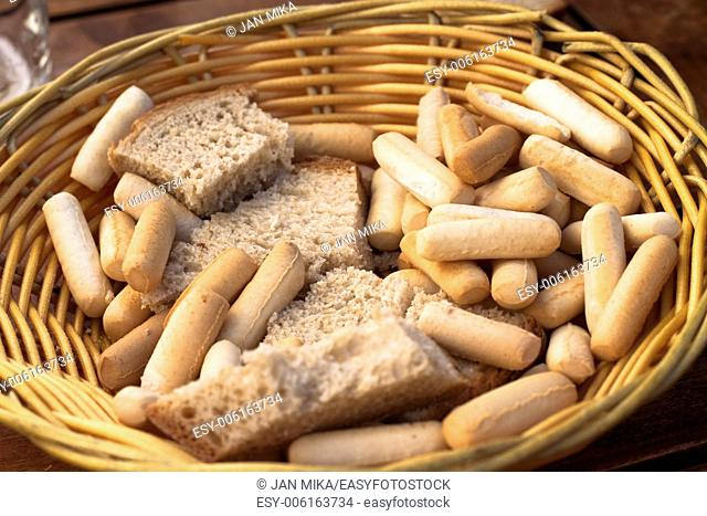 Detail of basket with bread and bread sticks in Spanish Tapas restaurant