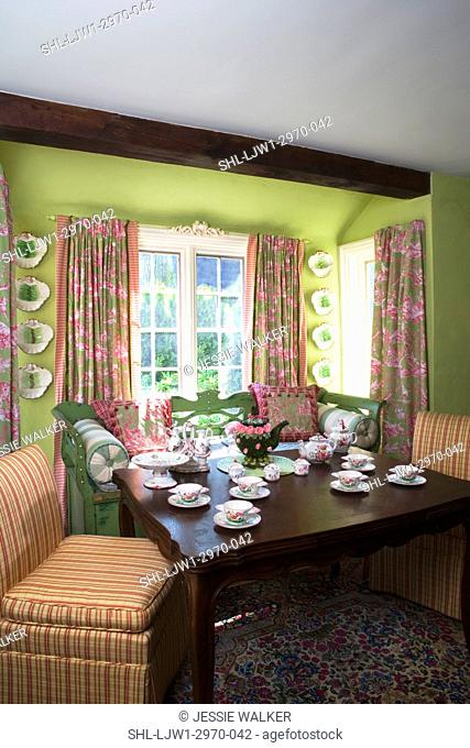 SITTING AREAS: painted green european wood bench, cushions and pilllows, twp striped slipper chairs, toile drapes in pink and green , bold lime green walls