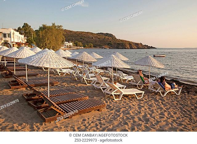 Sandy beach with thatched umbrellas at Gumusluk coast, Bodrum, Mugla, Aegean Sea, Turkish Riviera, Turkey, Europe