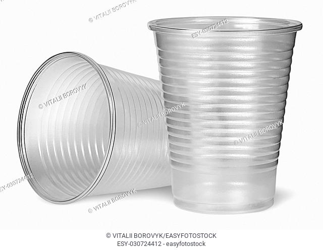 Lying and standing plastic cups isolated on white background