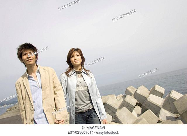 Couple walking along river bank