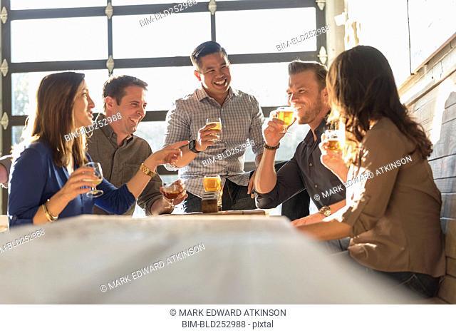 Friends drinking beer in brew pub