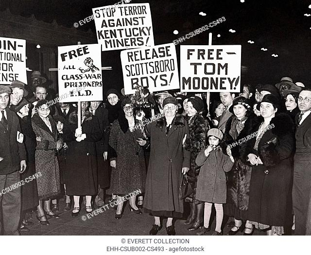 Members of the International Labor Defense greet Mrs. Mary Mooney (center). March 4, 1932. The mother of Thomas Mooney, campaigned against her son's corrupt...