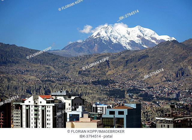 Illimani Glacier, 6,439 m, at front the skyscrapers of La Paz, Departamento La Paz, Bolivia