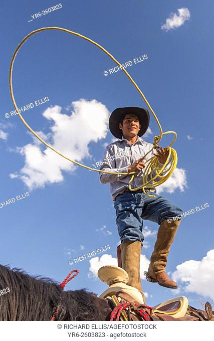 A Mexican charro or cowboy practices roping skills on his horse before a Charreada competition at a hacienda ranch in Alcocer, Mexico