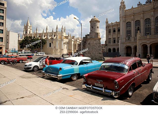 Old American cars near the Santo Angel Custodio church, Havana, Cuba, West Indies, Central America