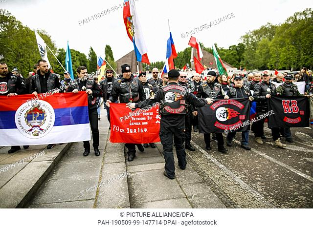 """09 May 2019, Berlin: Members and supporters of the motorcycle gang """"""""Night Wolves"""""""" visit the Soviet Memorial in Treptower Park on the occasion of the 74th..."""