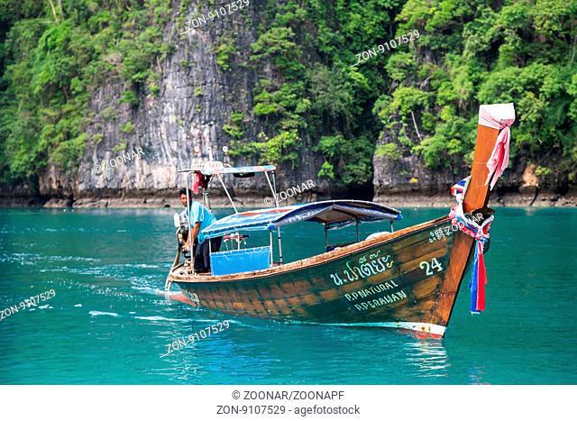 Boat sails in the Pileh Lagoon Phi Phi Lee island Andaman Sea Thailand