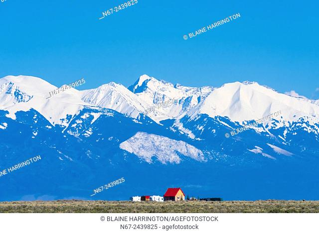 Snow capped peaks of the Sangre de Cristo range of the Rocky Mountains ring the San Luis Valley in Southern Colorado, USA