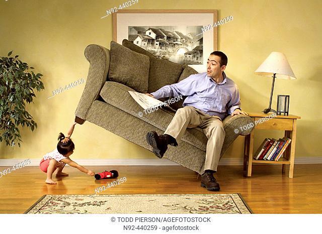 Girl lifting sofa