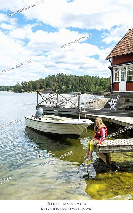 Girl sitting on jetty